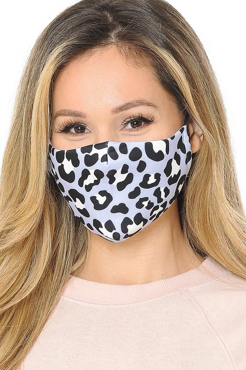 Front facing view of our fabric Soft Blue Leopard Graphic Print Face Mask with adjustable ear string sizing.