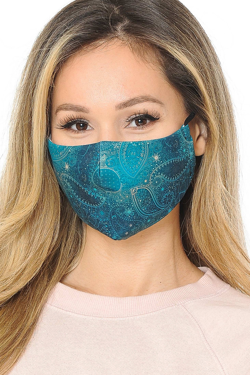 Emerald Paisley Graphic Print Face Mask with adjustable ear string sizing.