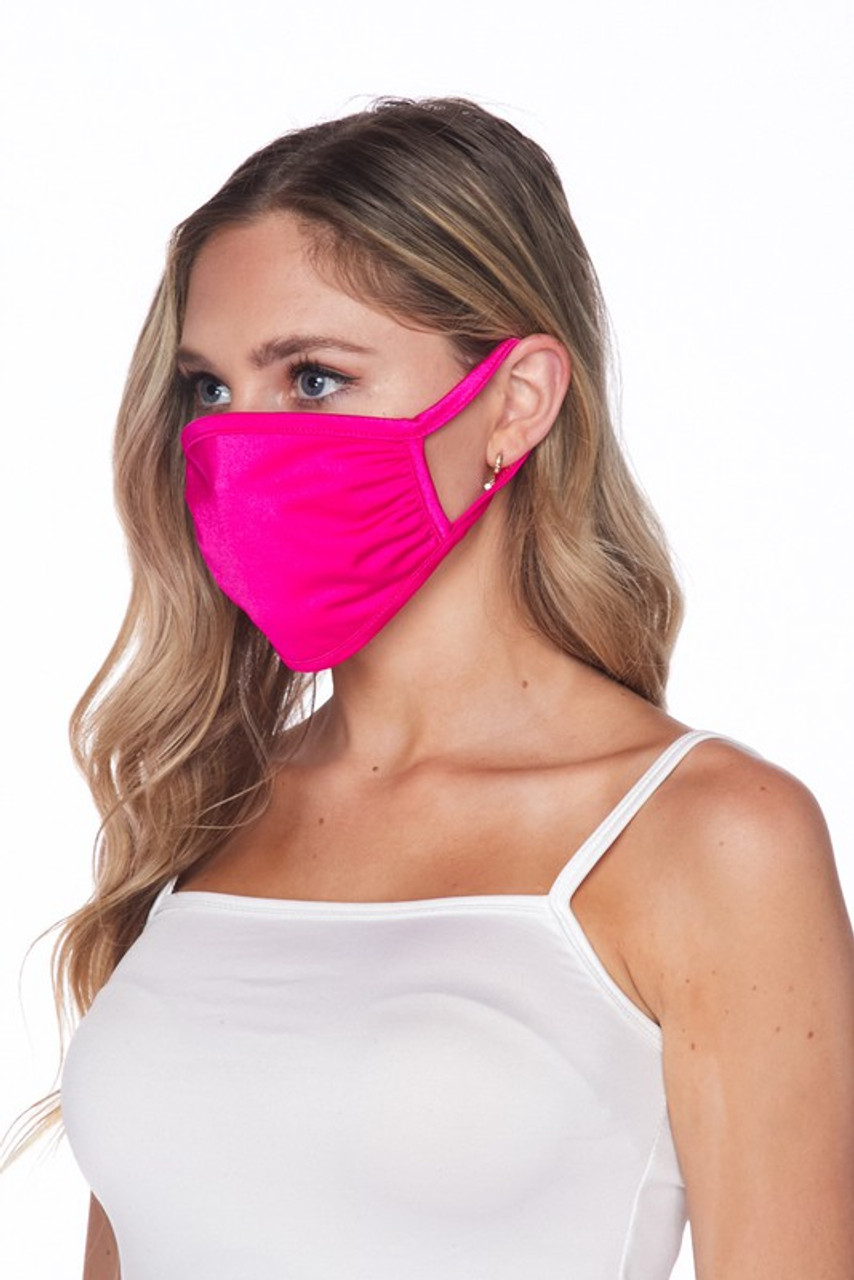 Side view of USA made fuchsia Solid Tricot Smooth Textured Face Mask that with earloop fit.