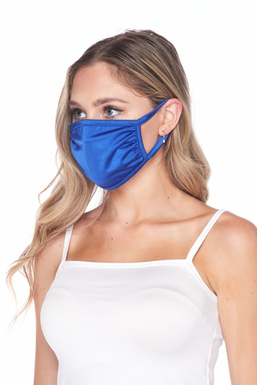 Side view of USA made blue Solid Tricot Smooth Textured Face Mask that with earloop fit.