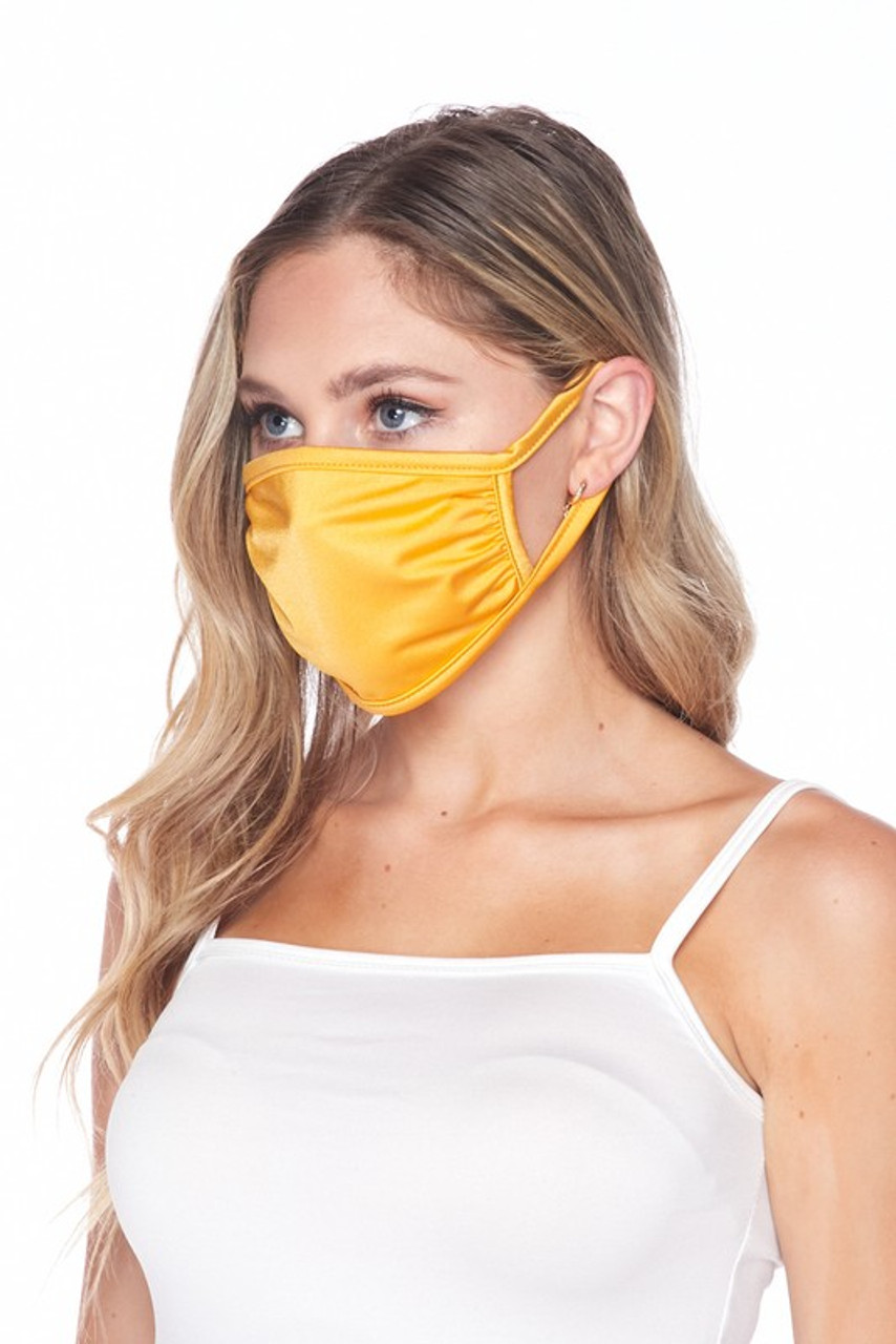 Side view of USA made mustard Solid Tricot Smooth Textured Face Mask that with earloop fit.