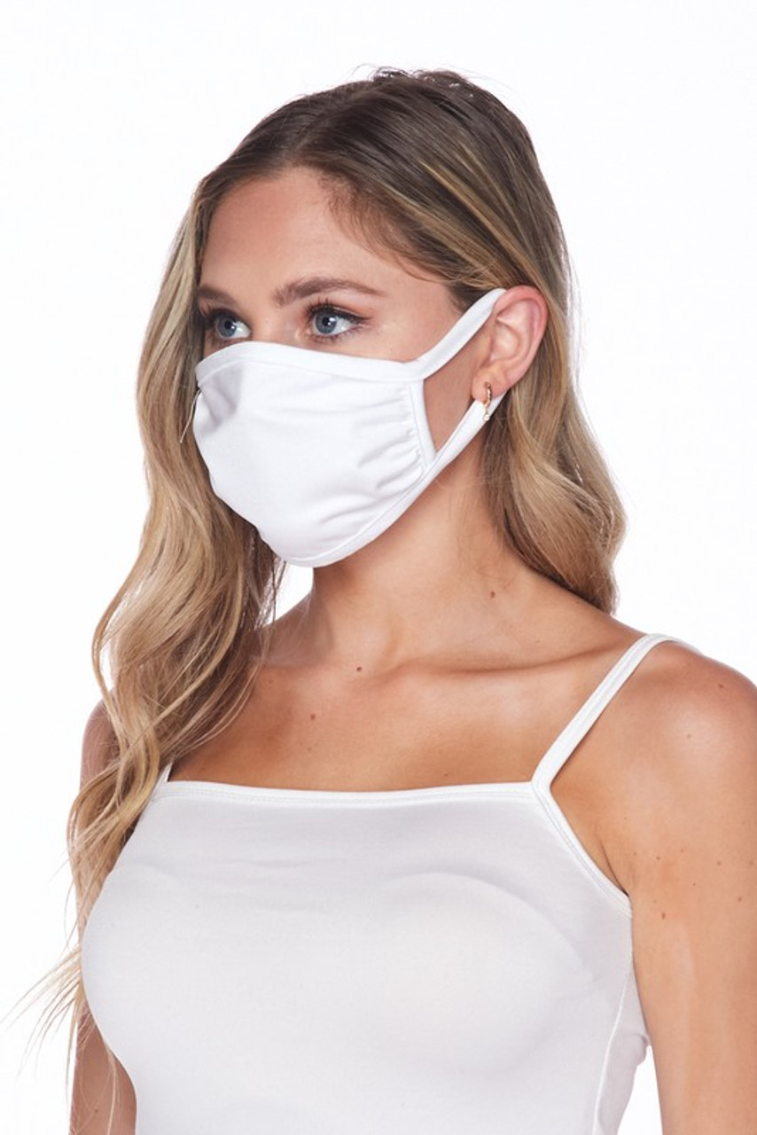 Side view of USA made white Solid Tricot Smooth Textured Face Mask that with earloop fit.