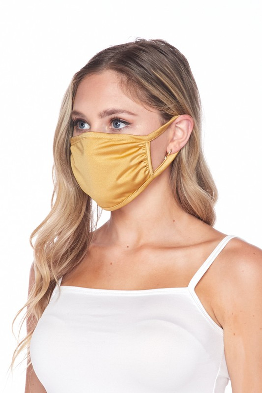 Side view of USA made gold Solid Tricot Smooth Textured Face Mask that with earloop fit.