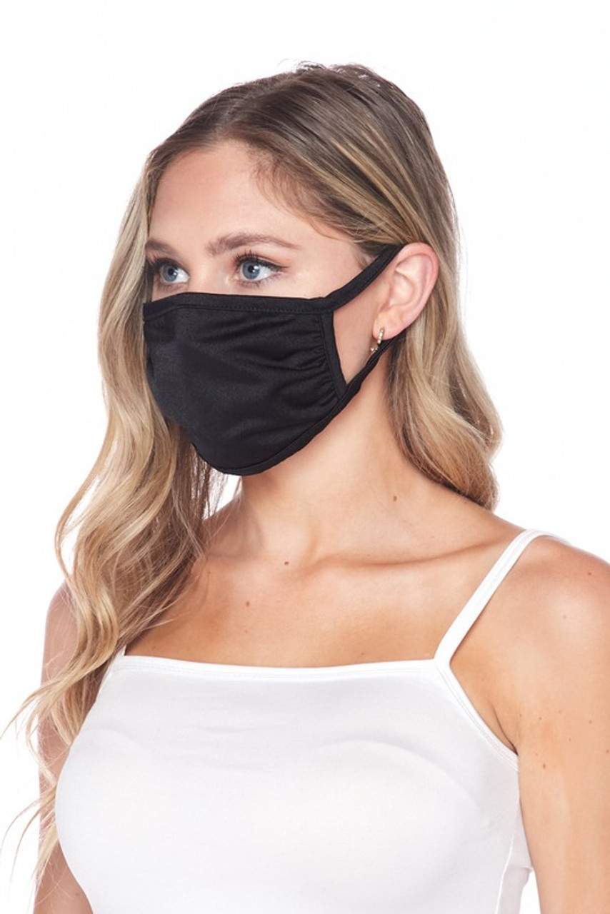 Side view of USA made black Solid Tricot Smooth Textured Face Mask that with earloop fit.