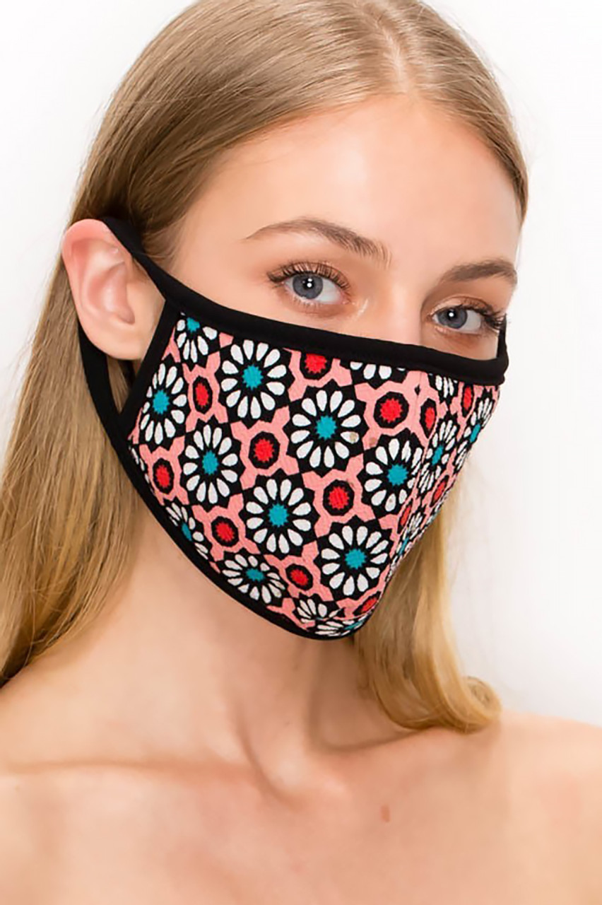 Angled front view of our pink Unisex Groovy Floral Face Mask - Made in USA with red, white, and teal floral accents.