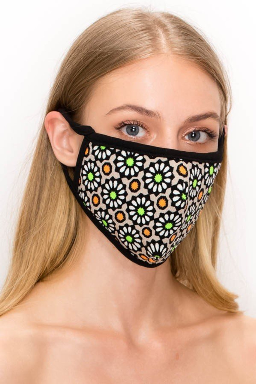 Angled front view of our mocha Unisex Groovy Floral Face Mask - Made in USA with white, green, and yellow floral accents.