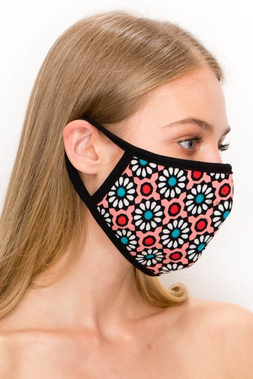 Right side view of our Unisex Groovy Floral Face Mask - Made in USA in pink, showing elastic looped ear supports.