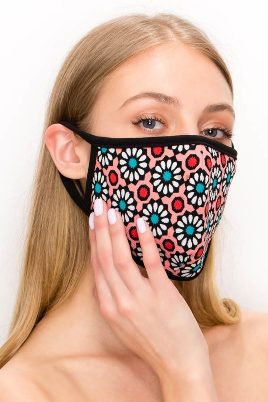 Partial front angled right view of pink Unisex Groovy Floral Face Mask - Made in USA