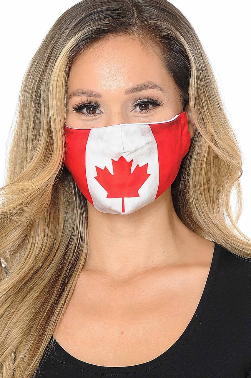 Front view image of Canadian Flag Graphic Print Face Mask featuring a red and white design with a maple leaf in the center.