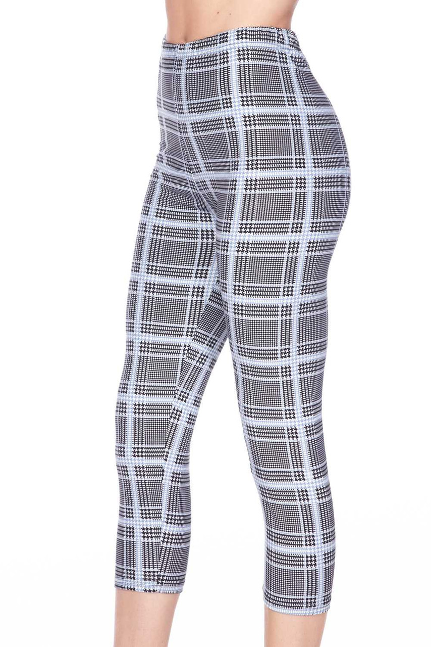 Left side view image of our cropped mid calf length Buttery Soft Baby Blue Glen Plaid Capris with a black and white design mixed with houndstooth and a  pastel blue grid overlay.
