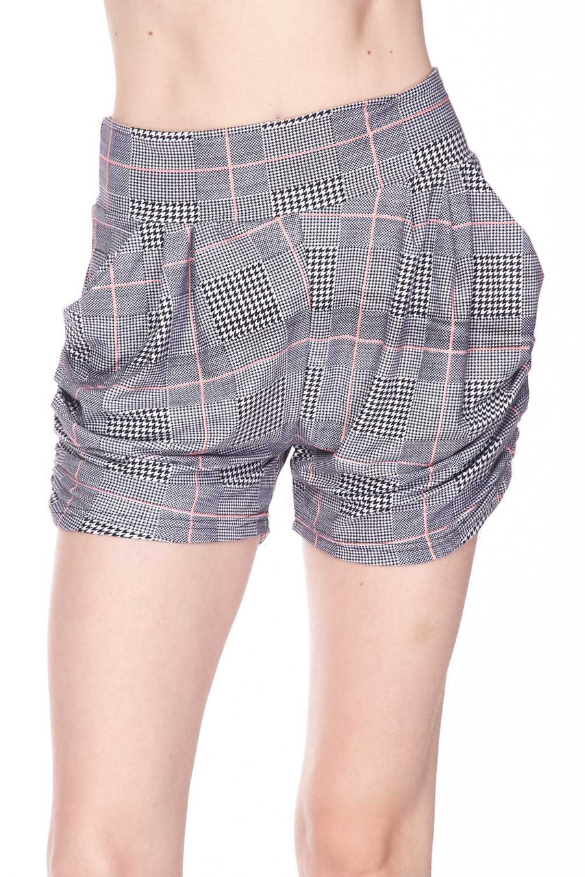 Front  view image of Buttery Soft Coral Accent Textured Houndstooth Harem Plus Size Shorts with a black and white design mixed with houndstooth and a thin pink grid overlay.