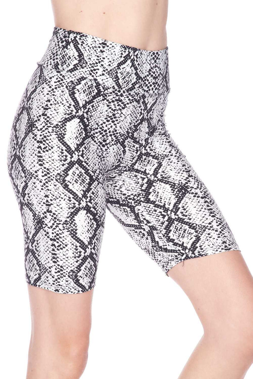 Right side view of our ultra comfortable  Buttery Soft White Snakeskin High Waist Plus Size Biker Shorts with a neutral color scheme that pairs with a top of any color.
