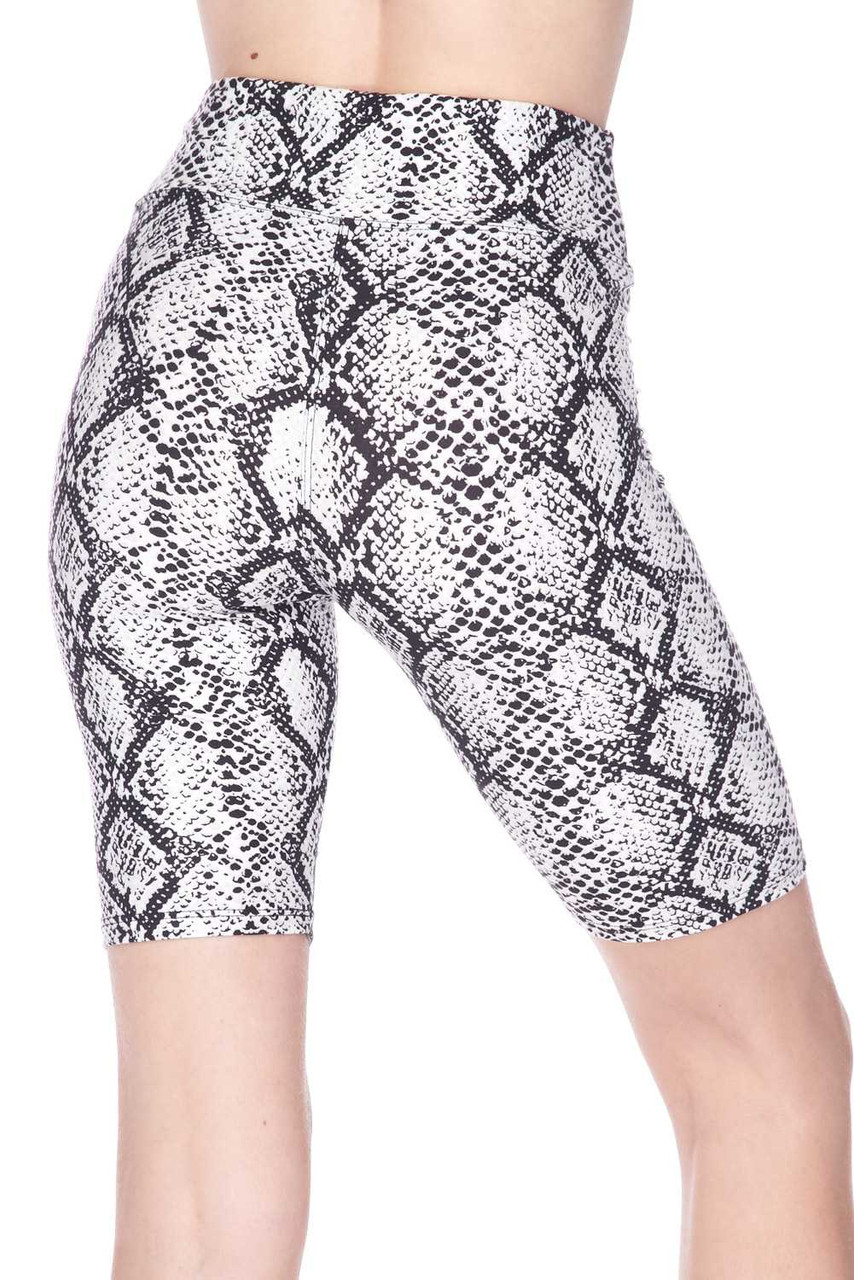 Rear view of ourButtery Soft White Snakeskin High Waist Plus Size Biker Shorts featuring a sassy reptile snake skin design.