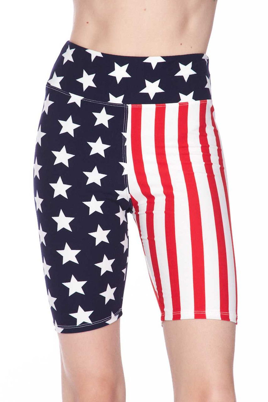 Front view of Buttery Soft USA Flag High Waist Biker Shorts - 3 Inch Waist featuring an American Flag inspired split leg design with one side having red and white vertical stripes, and a white stars on navy background on the other.