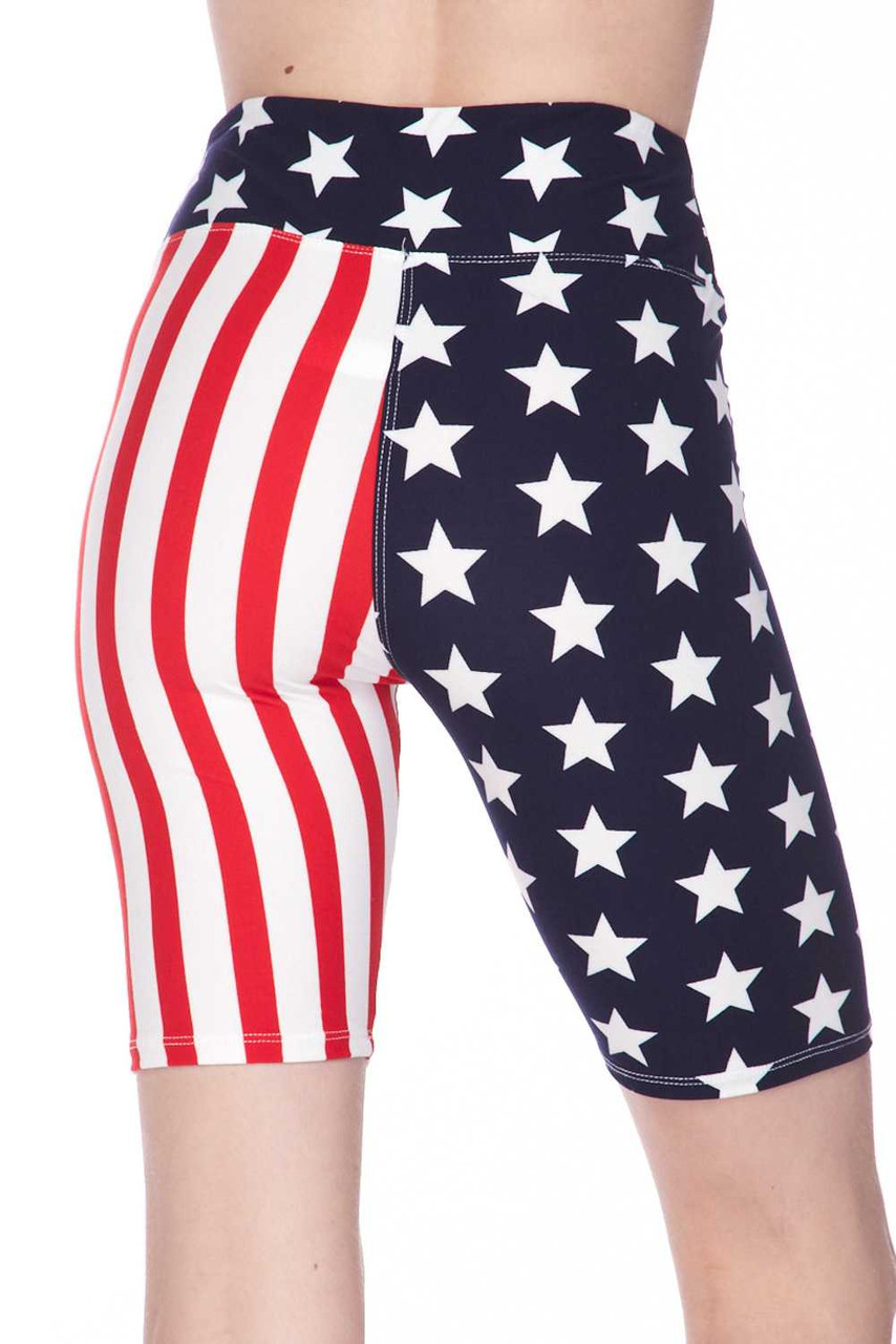Rear view image of mid thigh length Buttery Soft USA Flag High Waist Biker Shorts with a navy with white star print fabric waist.