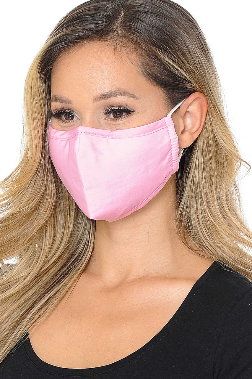 Partial front/right view image of pink Wholesale 3 Ply Face Mask with Inner Built in Filter - Nose Closure - Adjustable Ear Ties featuring a subtle sheen.