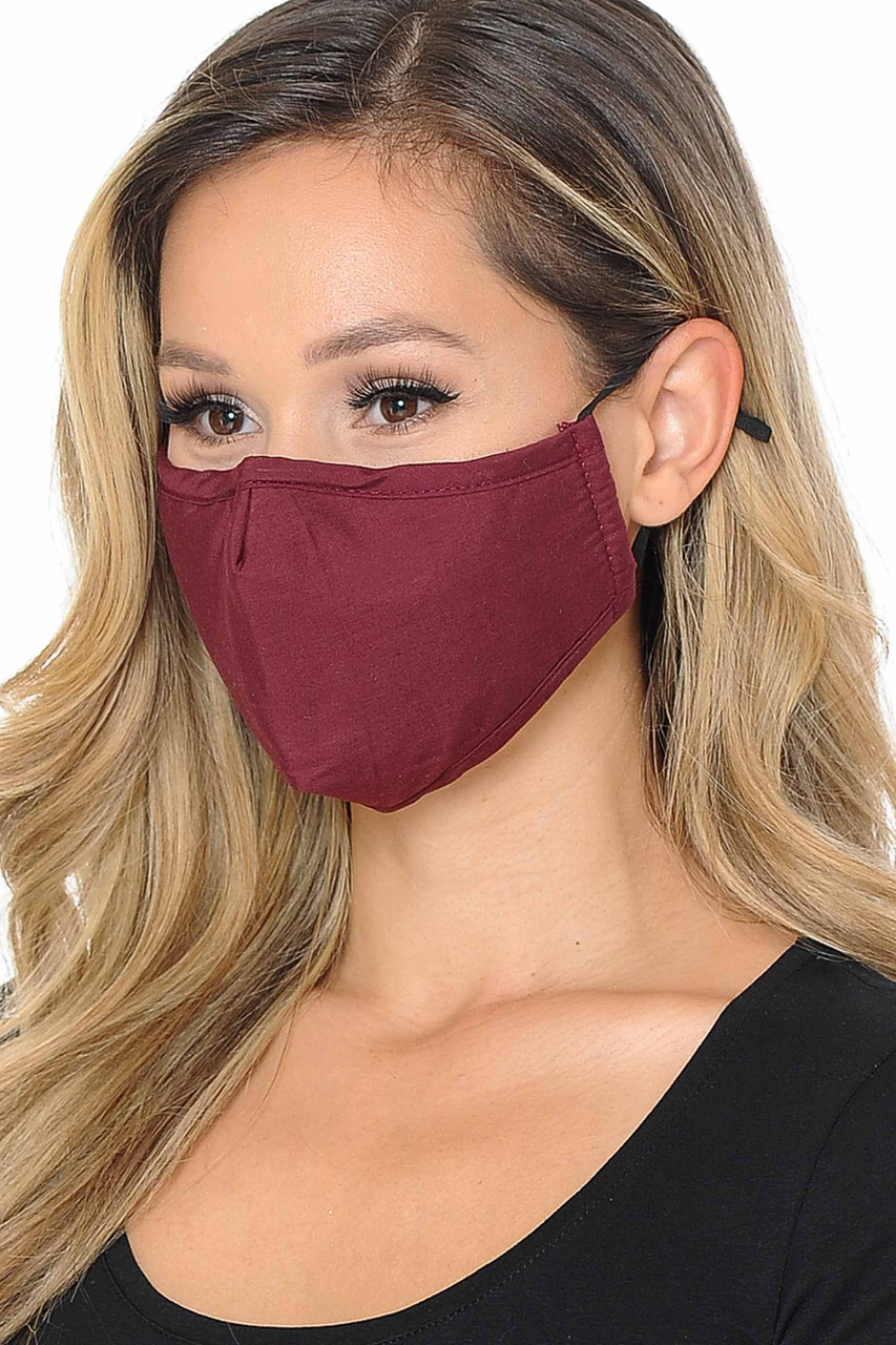 Partial front/right view image of burgundy Wholesale 3 Ply Face Mask with Inner Built in Filter - Nose Closure - Adjustable Ear Ties featuring a subtle sheen.