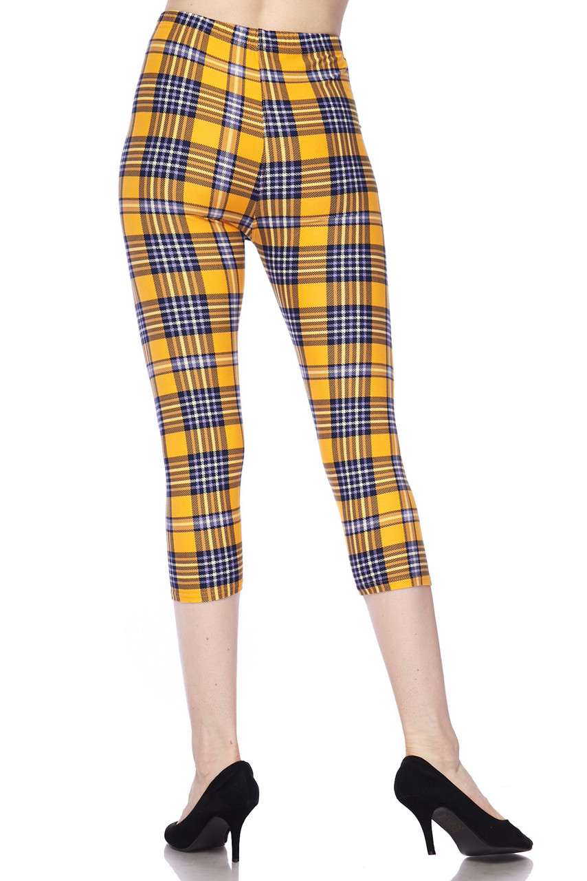 Back view image of our flattering body-hugging Buttery Soft Sunshine Plaid Plus Size Capris with a cropped mid calf length depending on height.