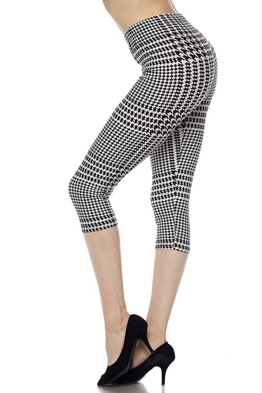 Left side view image of Buttery Soft Moving Houndstooth Plus Size Capris featuring a mixed large and small scale dogtooth print in a neutral black an white color scheme.
