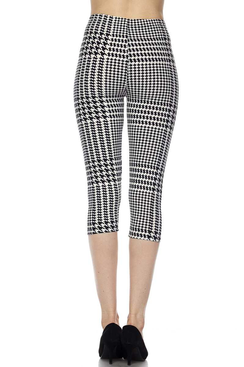 Back view image of Buttery Soft Moving Houndstooth Plus Size Capris showcasing the all over 360 degree classic print that is forever in style.
