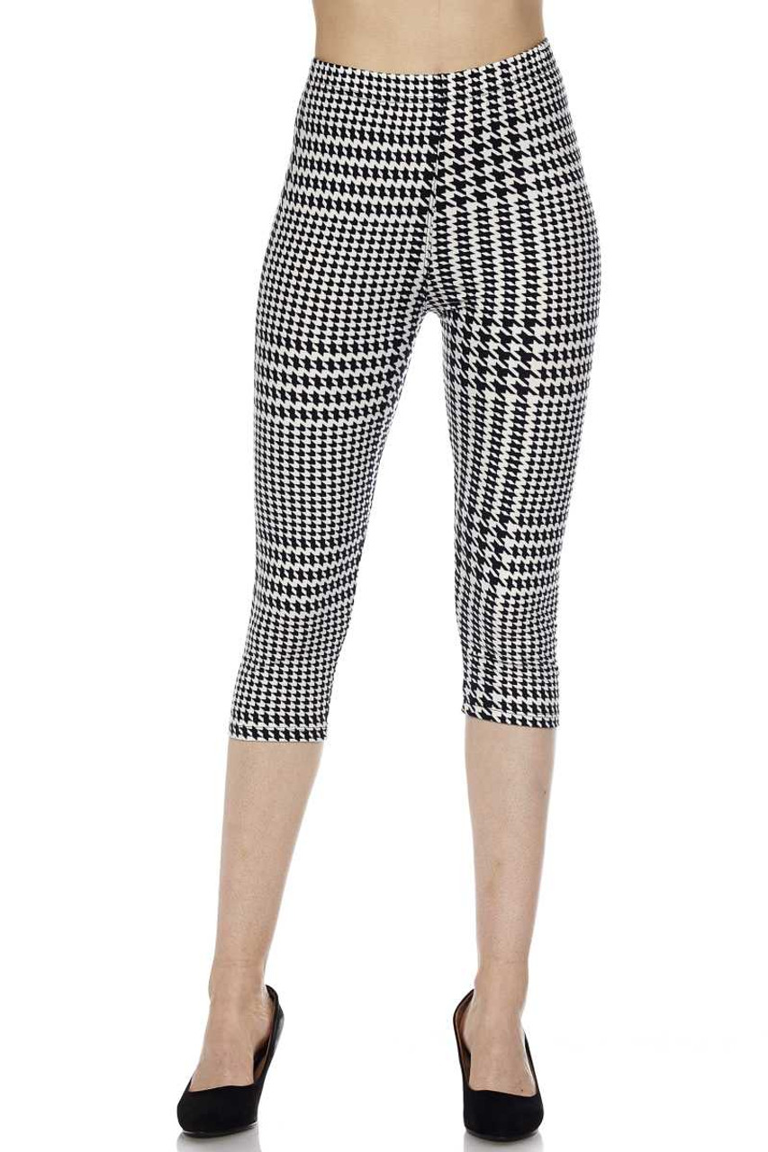 Front view image of mid riseButtery Soft Moving Houndstooth Plus Size Capris with a comfort stretch elastic waist.