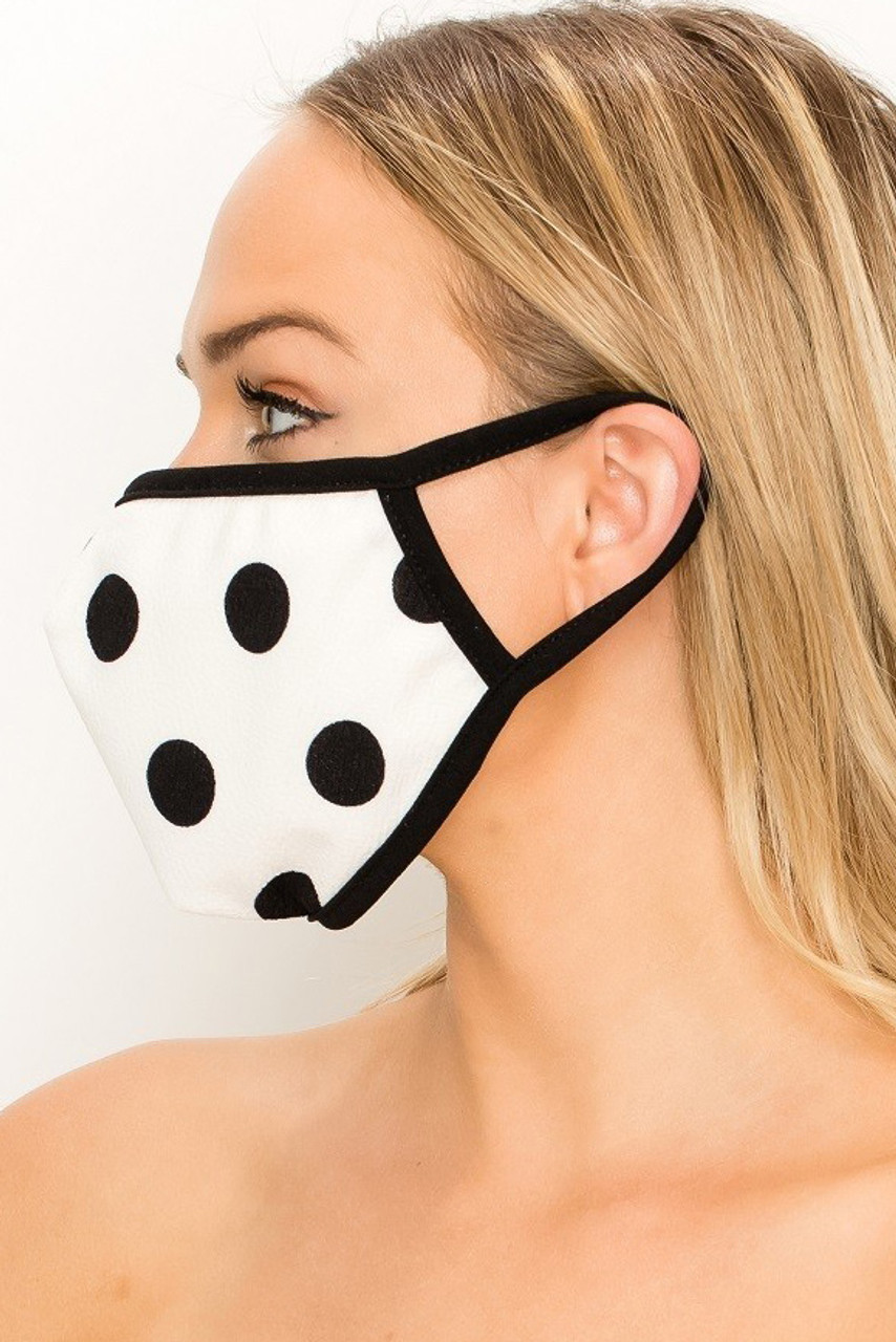 Left side view of Women's Crepe Polka Dot Face Mask - Made in the USA in White with Black contrast elastic ear supports