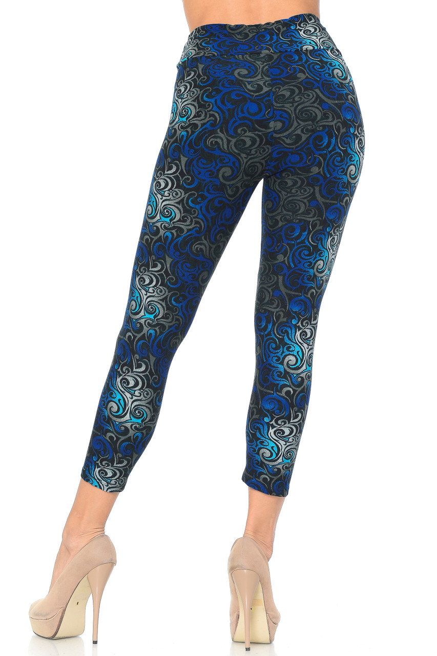 Rear view image of Blue Buttery Soft Tangled Swirl High Waisted Plus Size Capri with a cropped mid calf length depending on height.