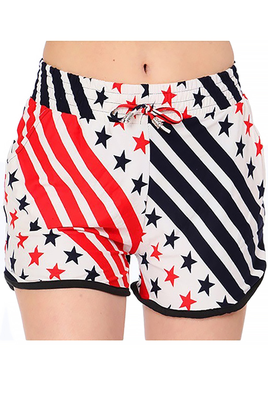 Front view of our Buttery Soft Twirling USA Flag Dolphin Shorts featuring an elastic tie string waist and an American themed red, white, and blue stars and stripes design.