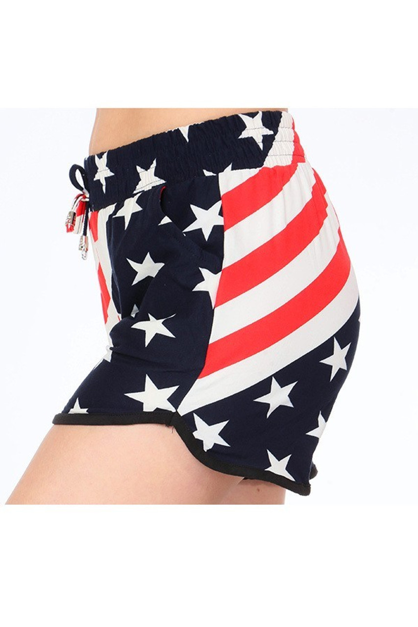 Left side view of Buttery Soft Swirling USA Flag Dolphin Shorts where both stars and stripes prints are visible.