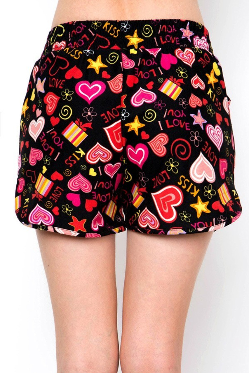 Back view image of our relaxed fit Buttery Soft Symbols of Love Dolphin Shorts