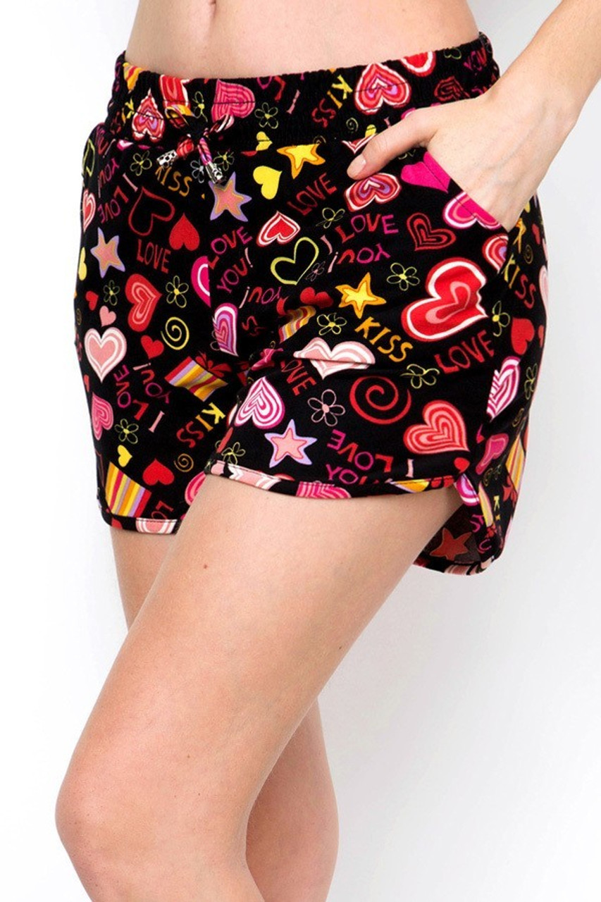 Left side view of Buttery Soft Symbols of Love Dolphin Shorts showing off convenient side pockets.