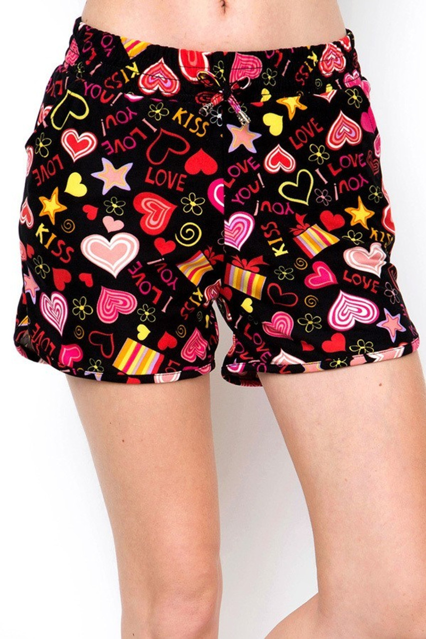 Front view of our Buttery Soft Symbols of Love Dolphin Shorts featuring an elastic tie string waist.
