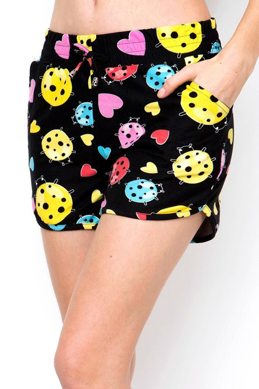 Left side view of Buttery Soft Ladybugs and Hearts Dolphin Shorts showing off side pockets.