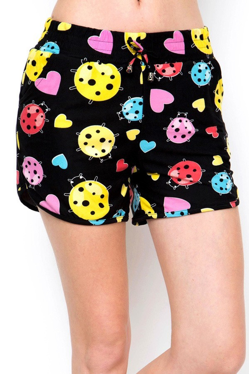 Our Buttery Soft Ladybugs and Hearts Dolphin Shorts feature an elastic stretch tie string waist.