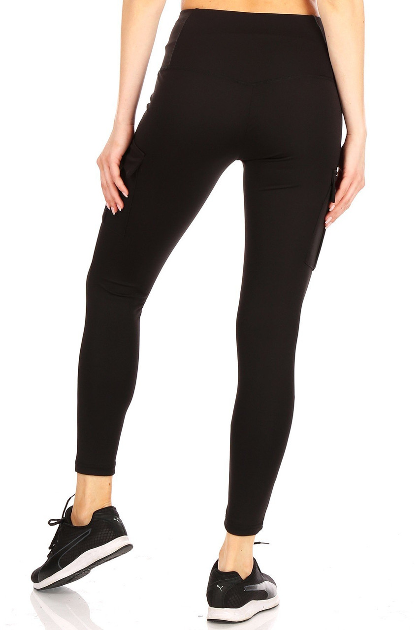 Rear view of our body forming Black Solid High Waist Tummy Control Sport Leggings with Cargo Pocket featuring a wonderful and durable four-way stretch fabric.