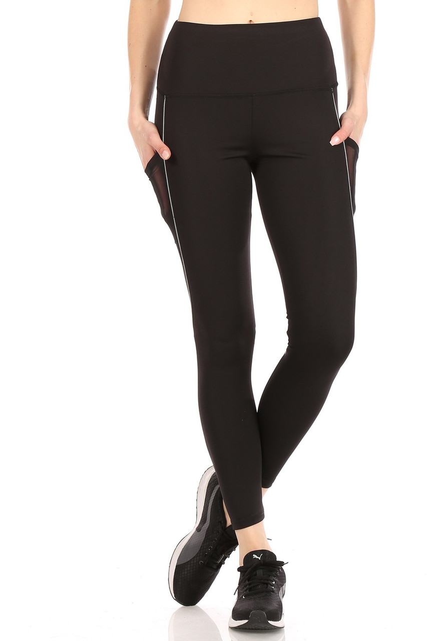 Front crossed leg view of Women's Mesh Pocket Tummy Control Workout Leggings with Reflective Trim with a comfort fabric waist.