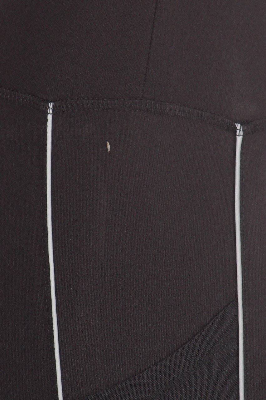 Close up fabric swatch of Women's Mesh Pocket Tummy Control Workout Leggings with Reflective Trim