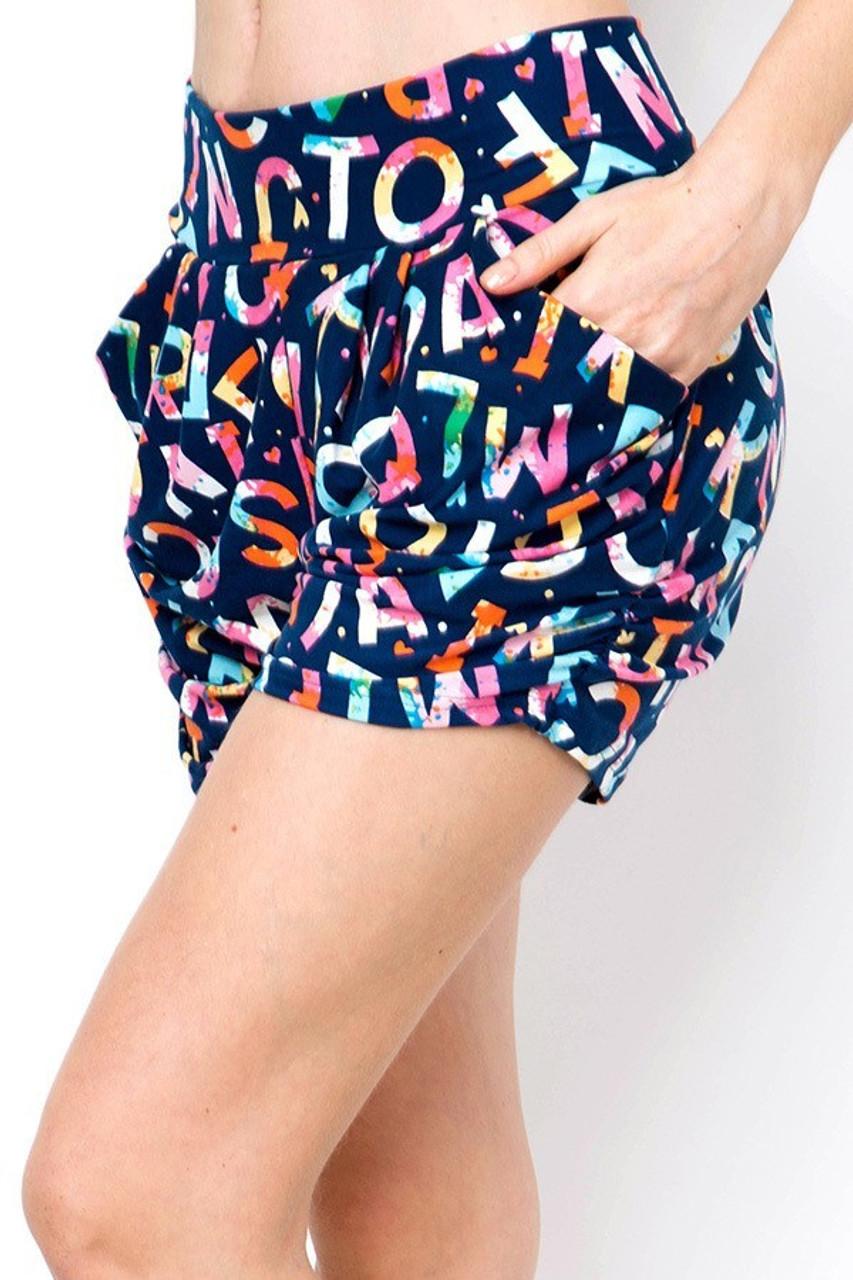 Left side of Buttery Soft Alphabet on Blue Harem Shorts showing convenient side pockets.