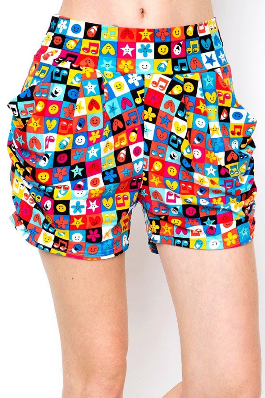 Front view of our non clingy Buttery Soft Everything Emoji Harem Shorts featuring a super colorful smiling icon filled checker design.