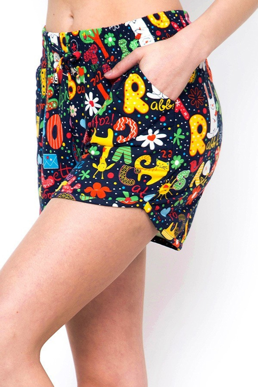 Left side view of Buttery Soft Animal Letters Dolphin Shorts showing off the functional side pockets.