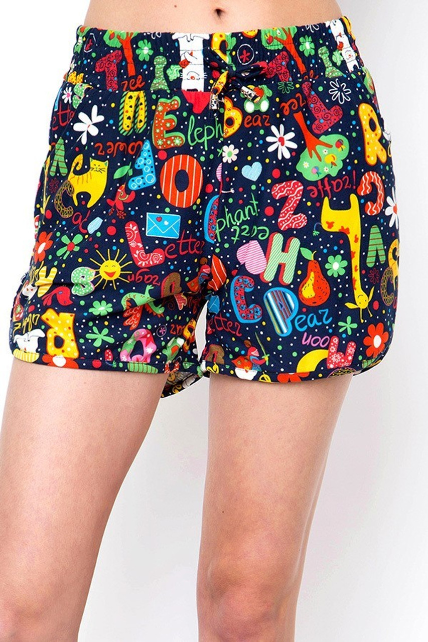 Front view of Buttery Soft Animal Letters Dolphin Shorts with an elastic tie string waist.