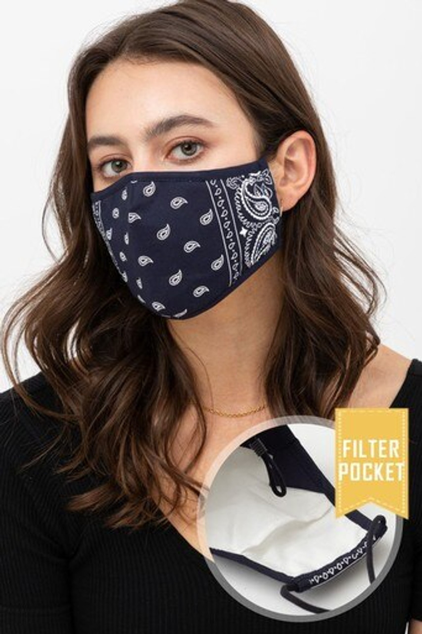 Modeled front view of Navy Bandana Fashion Face Mask with Built In Filter and Nose Bar featuring a white on deep blue paisley design.