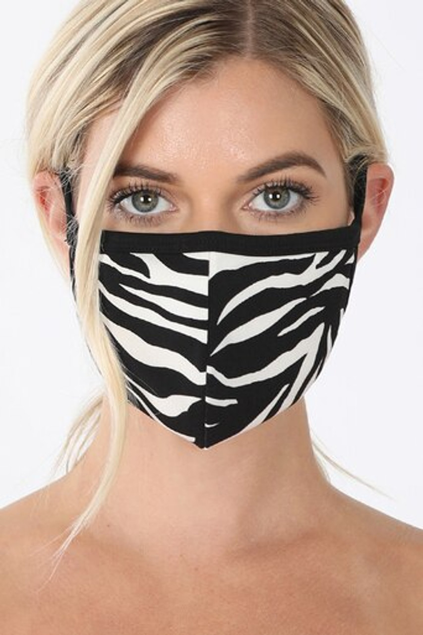 Front of Zebra Print Face Mask - Imported with a sassy black and white animal print stripe design.