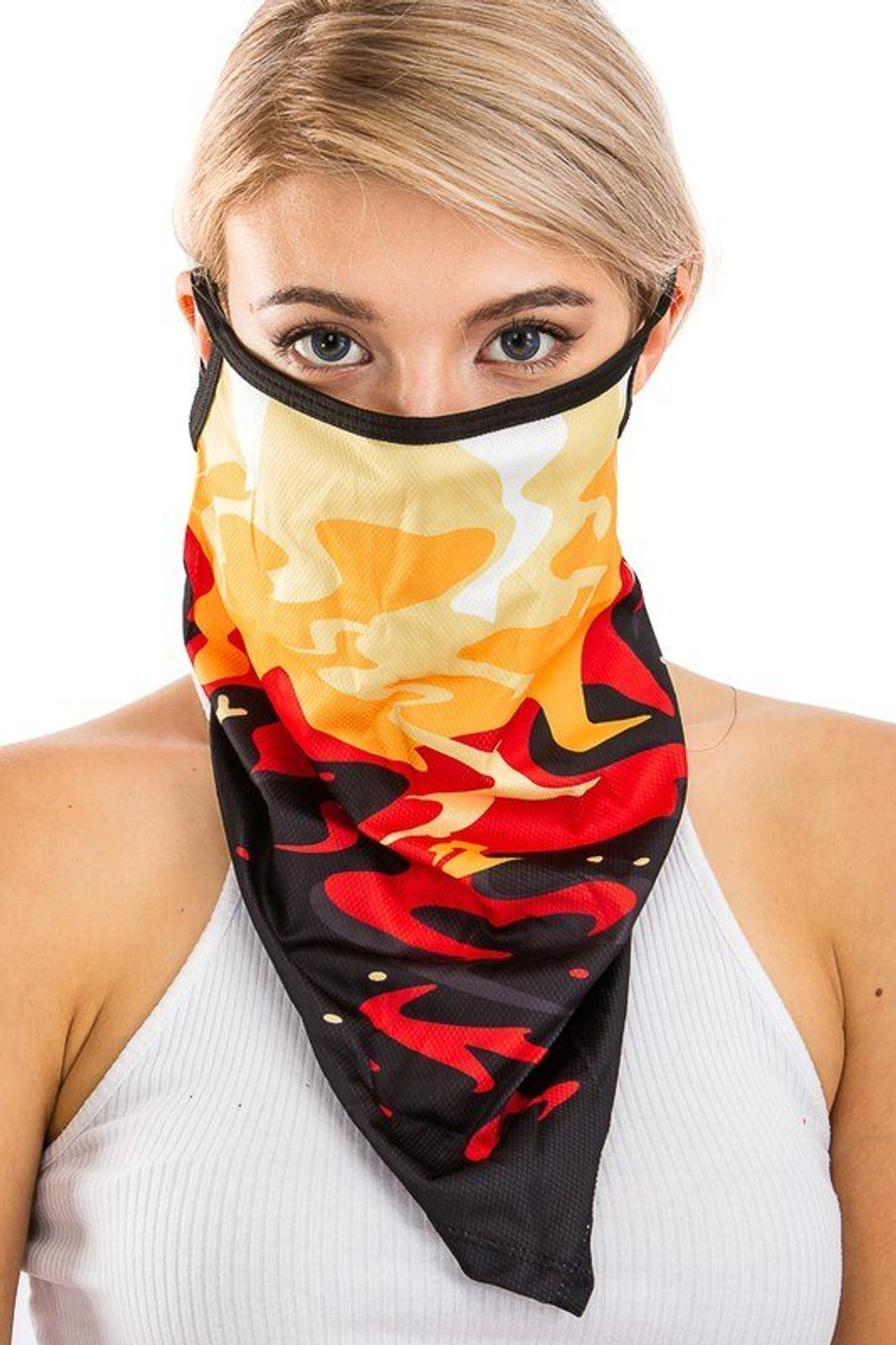 Front view of Color in Motion Balaclava Face Mask featuring a longer draping style and a stunning abstract print in a red, black, and orange color scheme.