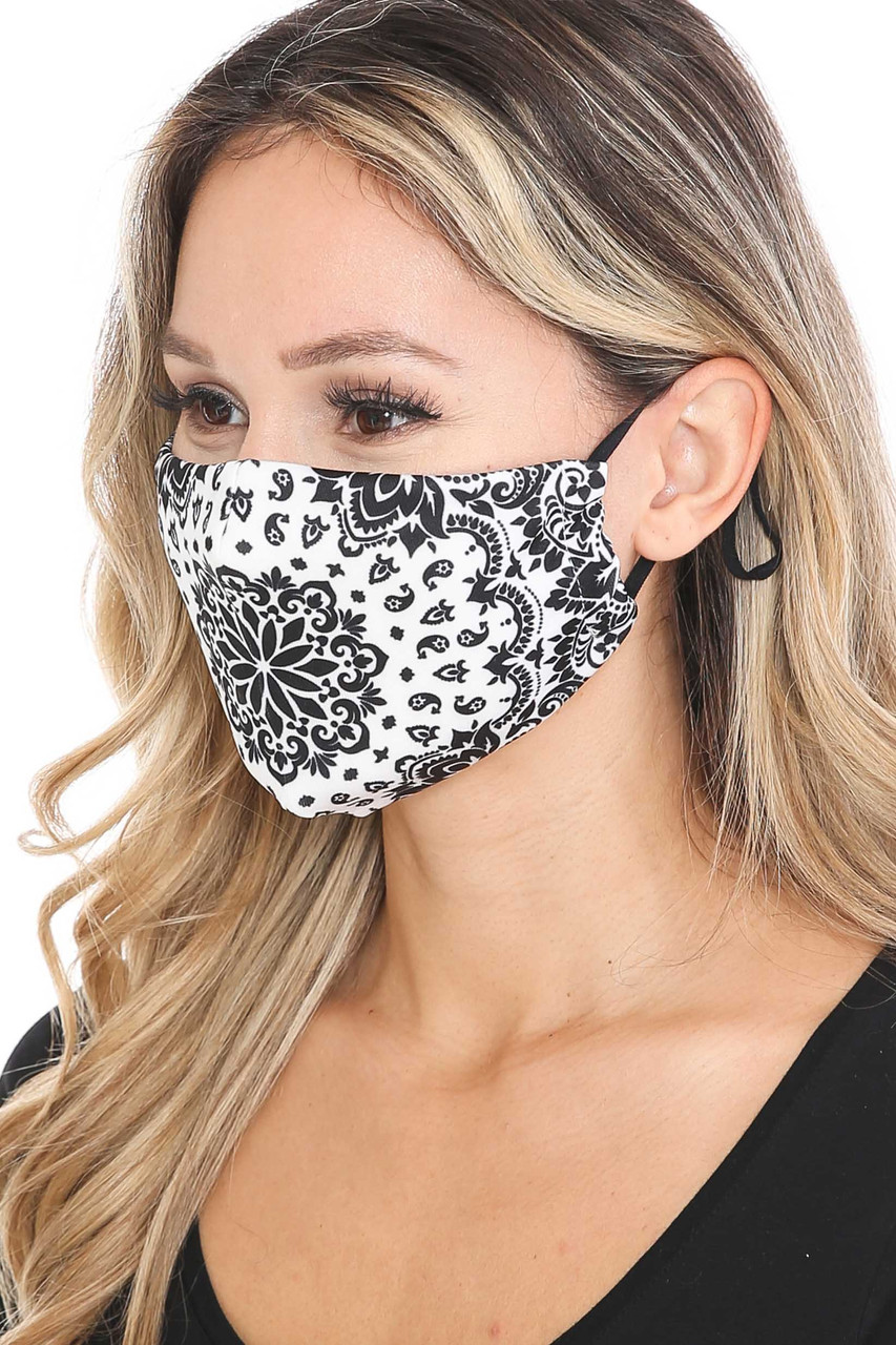 Left side view of Black and White Blooming Paisley Graphic Print Face Mask