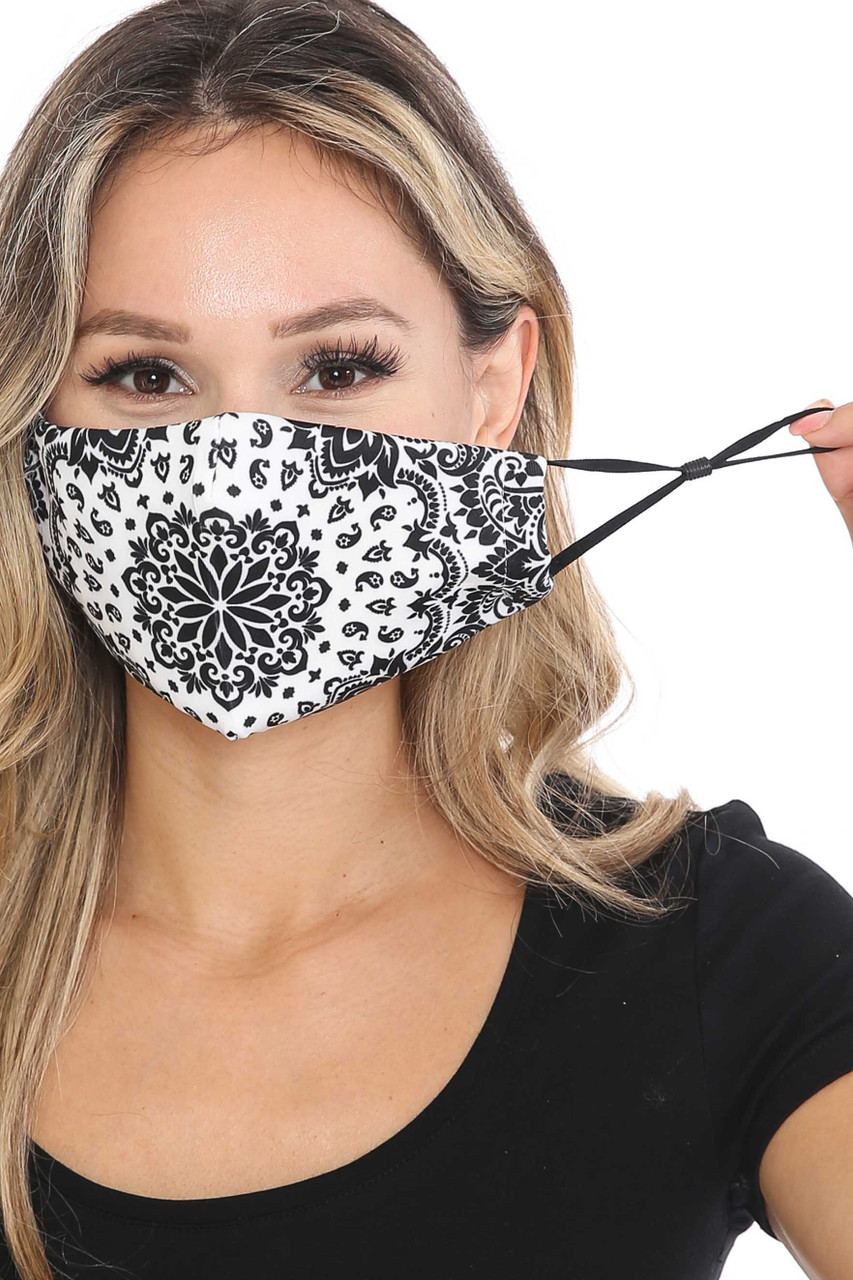 Front of Black and White Blooming Paisley Graphic Print Face Mask with adjustable ear strings.