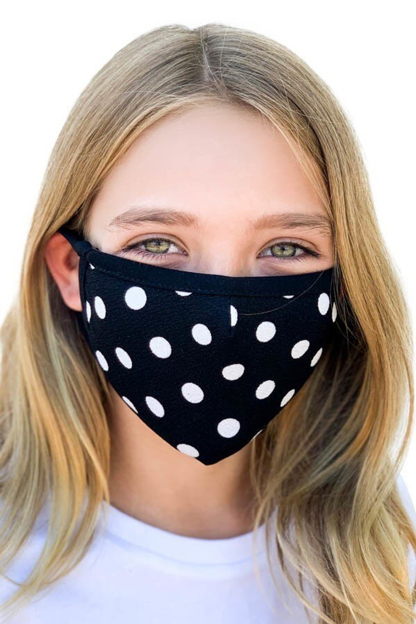Front view of Kid's Polka Dot Face Mask - Made in the USA with a neutral white on black design.
