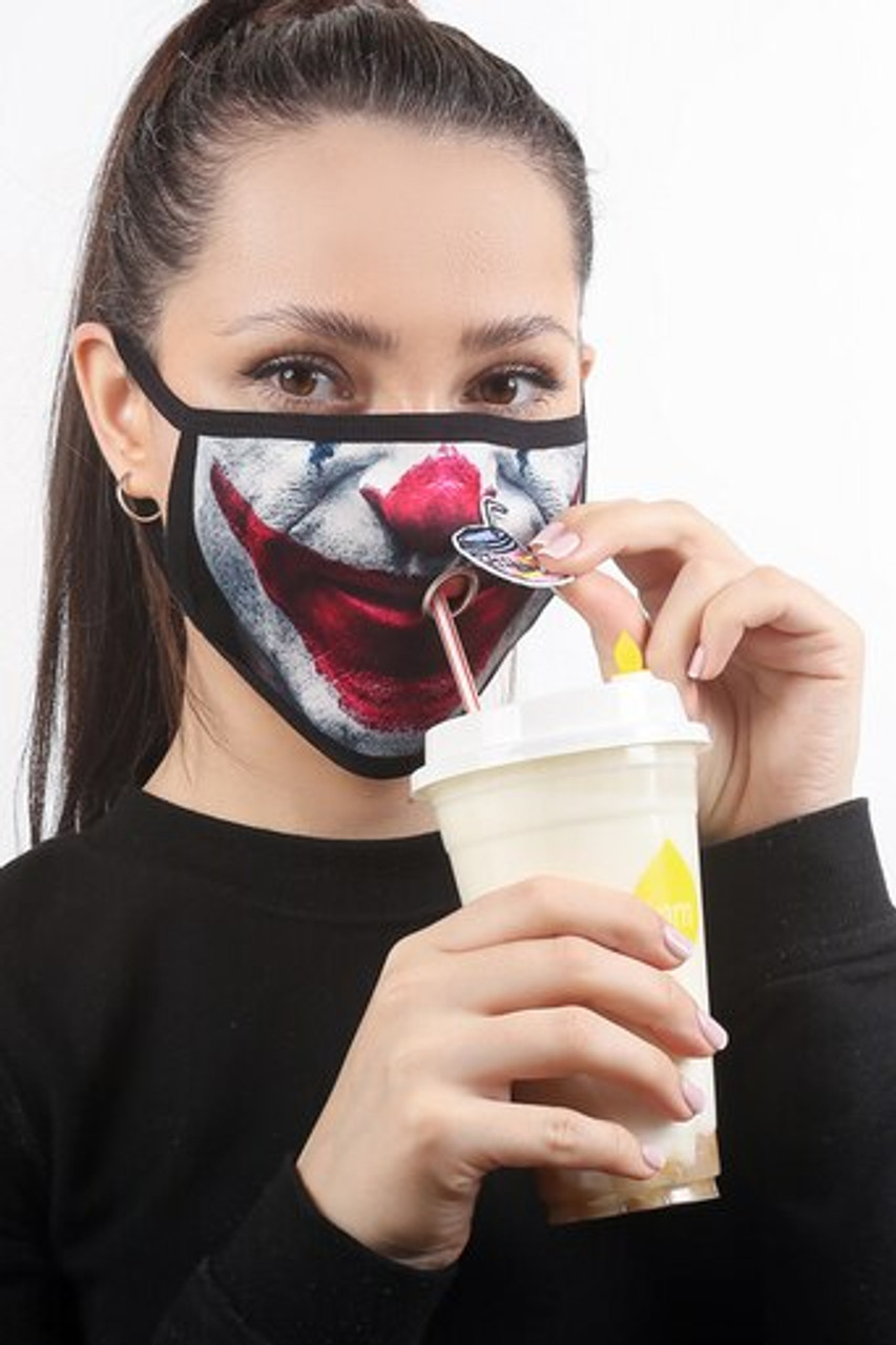 Image showing a beverage being consumed while wearing the Joker Graphic Print Face Mask with Magnetic Straw Hole