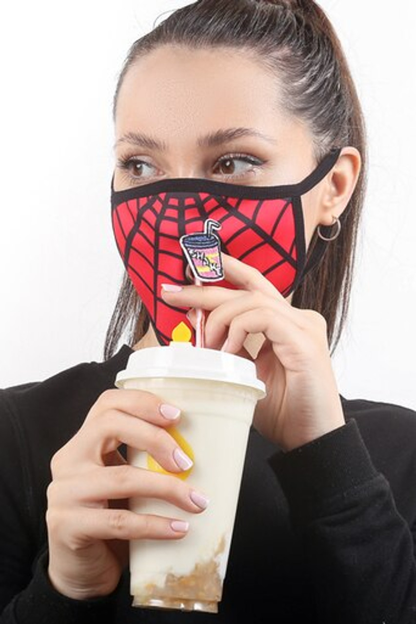 Image showing a beverage being consumed while wearing the Spiderman Web Graphic Print Face Mask with Magnetic Straw Hole