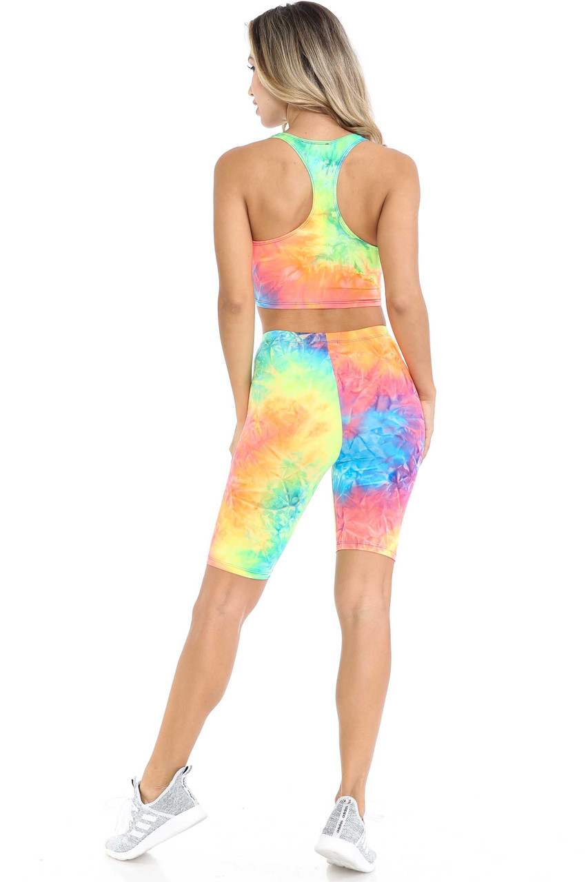 Back view of Neon Tie Dye 2 Piece Shorts and Cropped Bra Top Set shown styled with light gray sneakers.